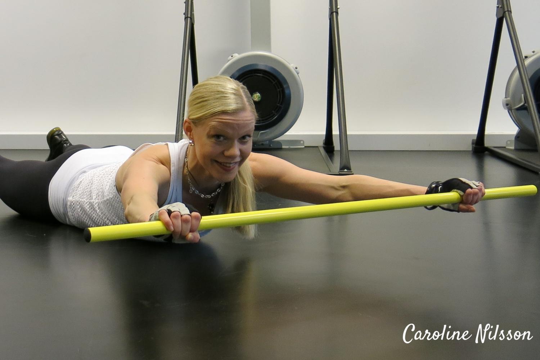 bra övning för ryggen med pinne eller käpp